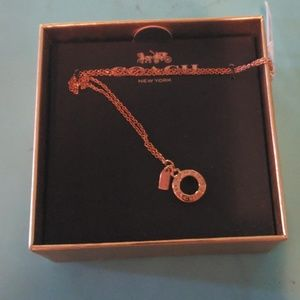 Coach rose gold necklace